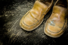 Close-up of grungy leather shoes Royalty Free Stock Photography