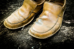 Close-up of grungy leather shoes Stock Photography