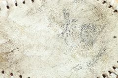 Grungy leather texture of a used baseball stock photos