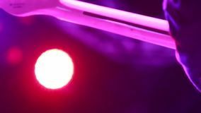 Close-up of guitar as guitarist does solo on stage stock footage