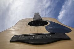 Close up guitar on blue sky background stock photos
