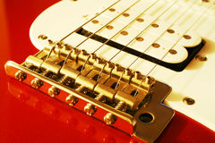 Close up of guitar bridge. Close up shot of red guitar royalty free stock images