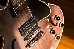 Close up guitar on the floor Stock Photos