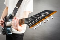 Close up on guitar fretboard. Of man playing electric guitar during gig or at music studio. Musical instruments, passion and hobby concept stock photos