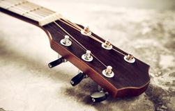 Close-up of a guitar fretboard. And headstock with tuners Royalty Free Stock Image