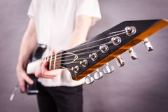 Close up on guitar fretboard. Of man playing electric guitar during gig or at music studio. Musical instruments, passion and hobby concept stock photography