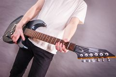 Close up on guitar fretboard. Of man playing electric guitar during gig or at music studio. Musical instruments, passion and hobby concept stock image