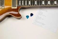 Close up guitar with guitar picks and song text Stock Photo
