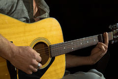 Close up guitar in guitarist hands Royalty Free Stock Photography