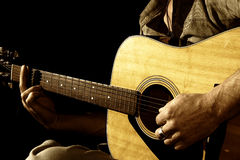 Close up guitar in hands Royalty Free Stock Photography