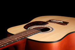 Close up of a guitar isolated on black Stock Image