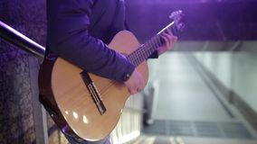 Close-up guitar. Man playing in the underground stock video footage