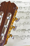 Close up of guitar neck with music Stock Photo
