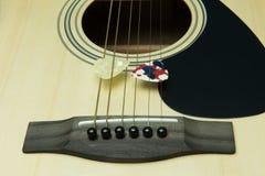 Close-up of a guitar and pick Stock Photos