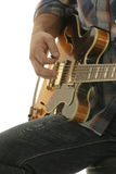 Close up guitar player. Close up of a guitar being played Royalty Free Stock Image