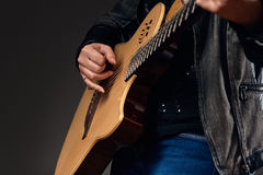 Close-up of the guitar player Stock Image