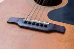 Close up of guitar with torn string Stock Images
