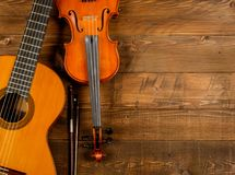 Guitar and violin in wood background. Close up of guitar and violin in wood background Stock Photography