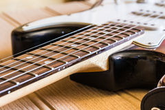 Close-up of a Guitar. On a wooden base Royalty Free Stock Photo
