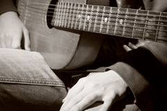 Close-up of guitarist with guitar sits before the performance Stock Photo