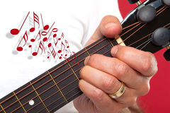Close up of guitarist hand playing Stock Photography