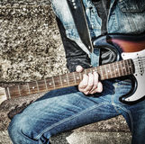 Close up of a guitarist playing on the street in hdr Stock Photography