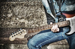 Close up of a guitarist playing on the street in hdr Royalty Free Stock Photos