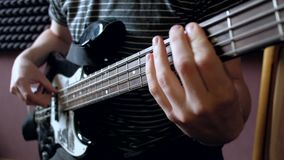 Musician plays on bass guitar in the Studio. stock video