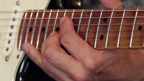 Close-up of a guitarist`s hand on the neck of the guitar playing showing how to do correctly the bending and the release technique. S stock footage