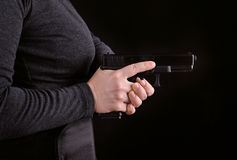 Close up of a gun in a hand stock photo