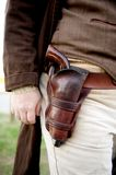 Close up of gun in a old western holster Royalty Free Stock Images
