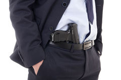 Close up of gun in policeman or bodyguard pants isolated on whit Stock Photo
