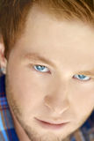 Close up of a guy. Close up of a young man with blue eyes Stock Photos