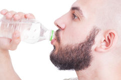 Close up with guy drinking water from plastic bottle Stock Image