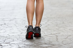 Close up on gym shoes on crack street Royalty Free Stock Photo