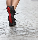 Close up on gym shoes on crack street Royalty Free Stock Photos