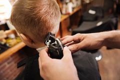 Close up of a hair cutting machine being in use. Modern device. Close up of a hair cutting machine being in use by a professional male hairdresser while working Stock Photography