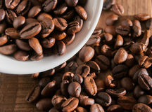 Close-up of half a cup of coffee beans Royalty Free Stock Photos