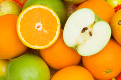 Close up of half cut oranges and apples Stock Photos