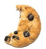 Close up of an half eaten cookie with crumb against a white back Royalty Free Stock Photos