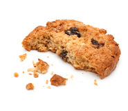 Close up of an half eaten cookie with crumb agains royalty free stock images