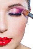 Close up of half-face of girl applying makeup Royalty Free Stock Photo