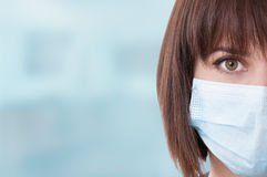 Close-up of half face and right eye of woman doctor Stock Images