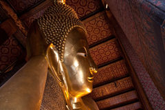 Close up at half of reclining buddha statue Stock Photography