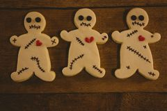 Close up of Halloween cookies arranged on wooden table Stock Photo