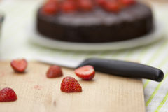 Close up of a halved strawberry on a chopping board Royalty Free Stock Images