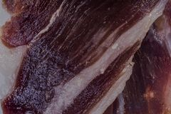 Detail ham iberico. Close up ham iberico, background of a slice of ham iberico Stock Image