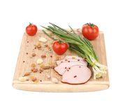 Close up of ham with nuts on board. Royalty Free Stock Photos