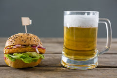 Close up of hamburger with beer glass Royalty Free Stock Photo