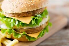 Close up of hamburger or cheeseburger on table Stock Photography